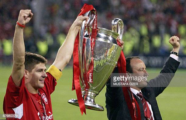 Liverpool's captain Steven Gerrard holds the throphy with Liverpool's Spanish Manager Rafael Benitez at the end of the UEFA Champions league football...
