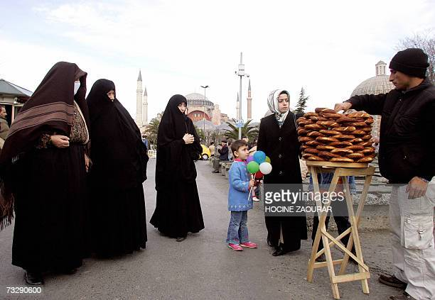 Turkish women buy traditional bread outside Istanbuls' Saint Sophia Cathedral 11 February 2007 AFP PHOTO/HOCINE ZAOURAR