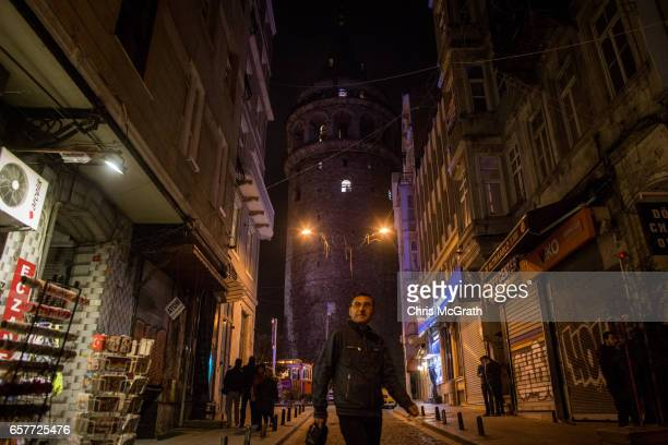 Istanbul's famous Galata tower is seen in darkness after switching of it's lights for the Earth Hour environmental campaign on March 25 2017 in...