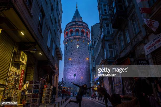 Istanbul's famous Galata tower is seen with it's lights on ahead of going dark for the Earth Hour environmental campaign on March 25 2017 in Istanbul...
