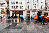 Istanbul, Turkey -November 28, 2015: Street car makes its way alongside shoppers crowding İstiklal Avenue. Known in English as Independence Avenue, the most famous shopping street in the country sees