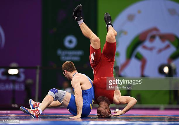 Istvan Levai of Slovakia and Denys Dem'Yankov of Ukraine compete in the Men's Wrestling 66kg Greco Roman bronze final during day two of the Baku 2015...