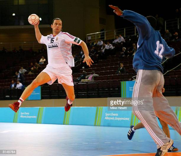 Istvan Pasztor of Hungary scores during the Athens 2004 Handball Test Event between Hungary and Egypt at the brand new Faliro Sports Pavilion on...