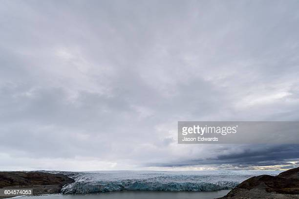 The ice fracture zone of a glacier on the Greenland Ice Sheet ending in a lake.