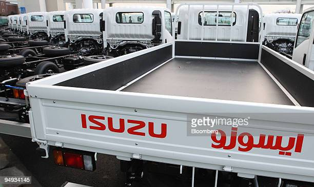 Isuzu Motors Ltd trucks bound for shipment wait in a lot in Yokohama City Japan on Wednesday Dec 10 2008 Isuzu Motors Ltd is Japan's largest maker of...
