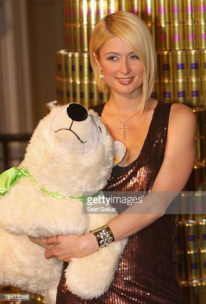 It girl Paris Hilton poses with a stuffed polar bear before signing autographs at the KaDeWe department store December 12 2007 in Berlin Germany The...