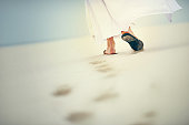 Shot of Jesus walking in a sandy landscape