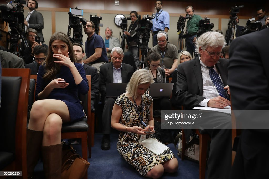 It is standing or kneeling room only as reporters, inlcuding NPR National Security Correspondent Mary Louise Kelly (C), crowd into the Senate Radio/TV Gallery to hear Senate Intelligence Committee Chairman Richard Burr (R-NC) (R) and ranking member Sen. Mark Warner (D-VA) conduct a news conference about the committee's investigation into Russian interference into the 2016 presidential election at the U.S. Capitol March 29, 2017 in Washington, DC. The senators said that an unprecedented number of committee staff have been given access to information from the intelligence community during this investigation.