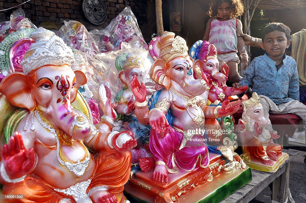 It is time to welcome the lord of prosperity as an artist brightens up the idol of Ganesha near Sahibabad police station GT road on September 8, 2013 in Ghaziabad, India. Ganesh Chaturthi, which begins from September 9, is celebrated as the birthday of Lord Ganesha who is widely worshiped by Hindus as the god of wisdom, prosperity and good fortune.