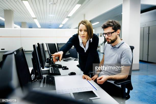 It professionals in control room