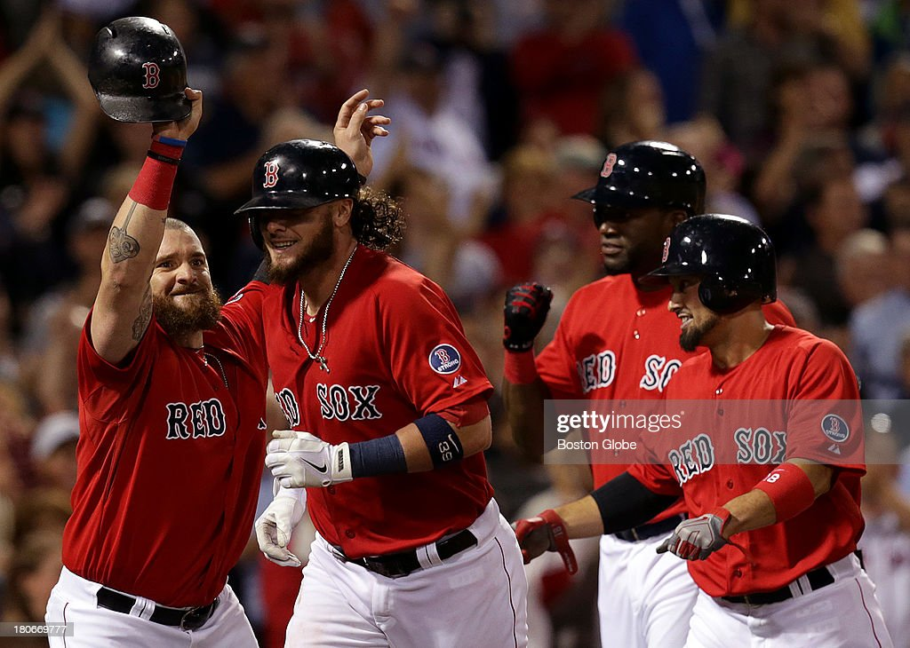 It was a celebration at home plate for Boston Red Sox catcher Jarrod Saltalamacchia (#39) after his Grand slam in the seventh inning. The Boston Red Sox take on the New York Yankees in Game one of a three game series at Fenway Park.