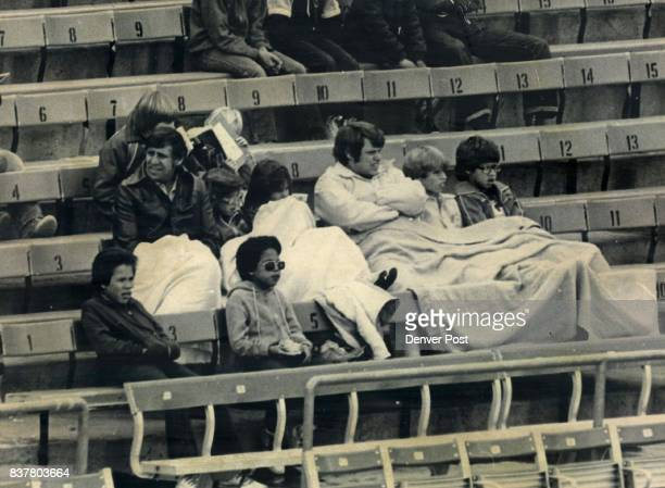 It was Baseball Played in Football Weather at Mile High Stadium A portion of the crowd of 5106 at the Denver Bears opener huddles under blankets to...