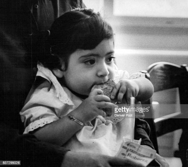It was cookies and fun at Seawall Rehabilitation Center Party A thoughtful 18monthold Theresa Garcia above munches a cookie she and Michael Prier...