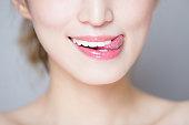 close up of beauty woman teeth and tongue