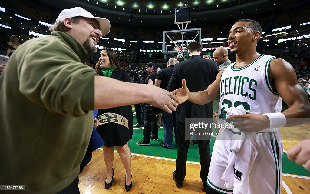It was 'Fan Appreciation Night' at TD Garden, and after the game, randomly selected fans were allowed on the court and were given jerseys by the players. This fan had a big grin and a hearty handshake for guard Phil Pressey. The Boston Celtics hosted the Washington Wizards in their final NBA game of the season at the TD Garden on Wednesday, April 16, 2014.