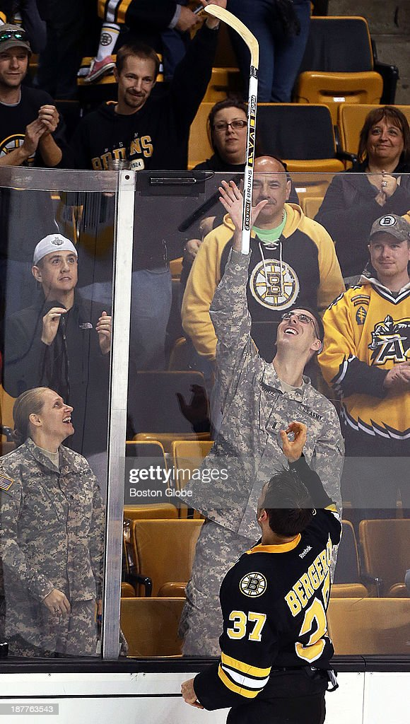 It was 'Military Appreciation Day' as well as Veteran's Day at the Garden, and after the game, the game's second star, Bruins center Patrice Bergeron tossed a stick to two service members in the crowd. The Boston Bruins hosted the Tampa Bay Lightning in an NHL regular season game at TD Garden.