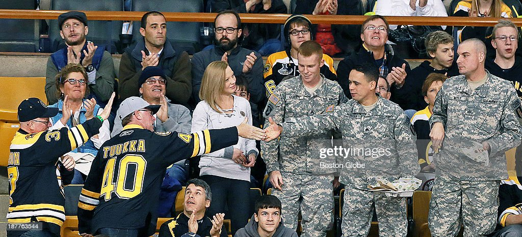 It was 'Military Appreciation Day' as well as Veteran's Day at the Garden, and during a timeout, anyone who had served, past of present, were asked to stand and be recognized. Two men in Bruins jerseys stood and offered a handshake to three service members in the crowd. The Boston Bruins hosted the Tampa Bay Lightning in an NHL regular season game at TD Garden.