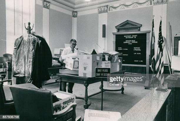 It Was Moving Day for the Courts Robert Y Uyeda clerk for Dist Judge Edward J Byrne makes a lastminute check of materials in a cluttered courtroom...