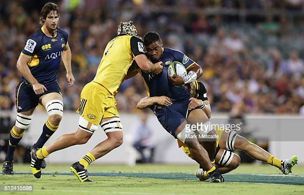 Ita Vaea of the Brumbies is tackled during the round one Super Rugby match between the Brumbies and the Hurricanes at GIO Stadium on February 26 2016...