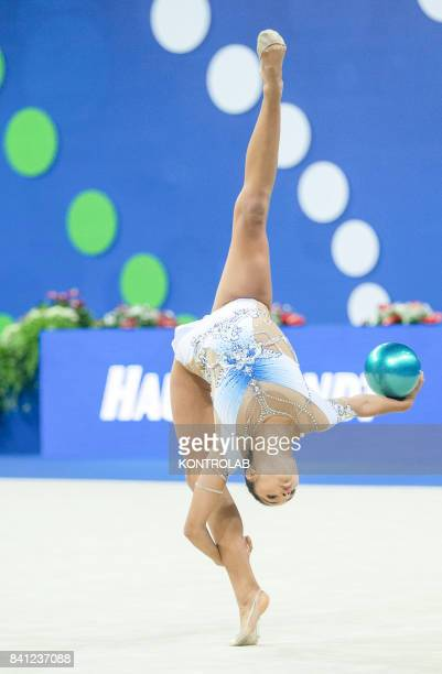Itaian Alexandra Argiuculese performs the ball exercise during the FIG 35th Rhytmic Gymnastic World Championship in Pesaro