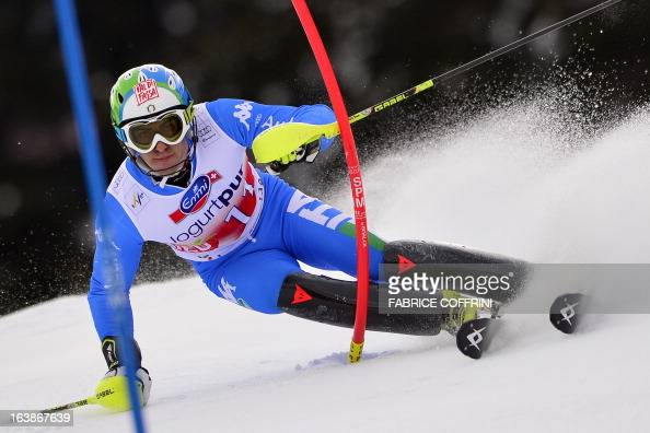 Itaian Stefano Gross competes during the Men Slalom race at the Alpine ski World Cup finals on March 17 2013 in Lenzerheide AFP PHOTO / FABRICE...