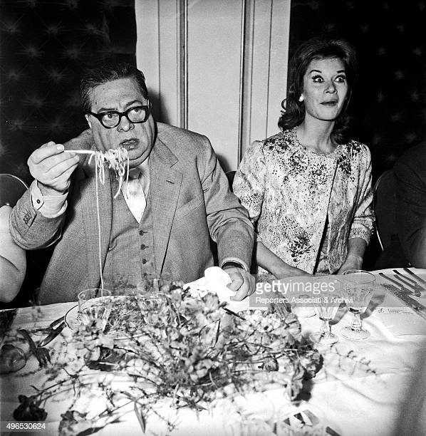Italian actor Aldo Fabrizi eating spaghetti in a restaurant Rome 1960