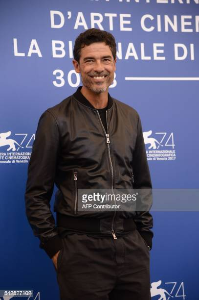 Italian actor Alessandro Gassmann attends the photocall of the movie 'Gatta Cenerentola' presented in the 'Orizzonti' selection at the 74th Venice...