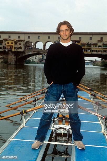 Italian actor Alessandro Preziosi posing on a fourrowers craft Florence 1999
