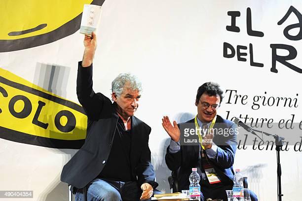Italian actor and comedian Gioele Dix with Italo Calvino's book is acclaimed by Director of Il Senso del Ridicolo Humor Festival Italian author and...