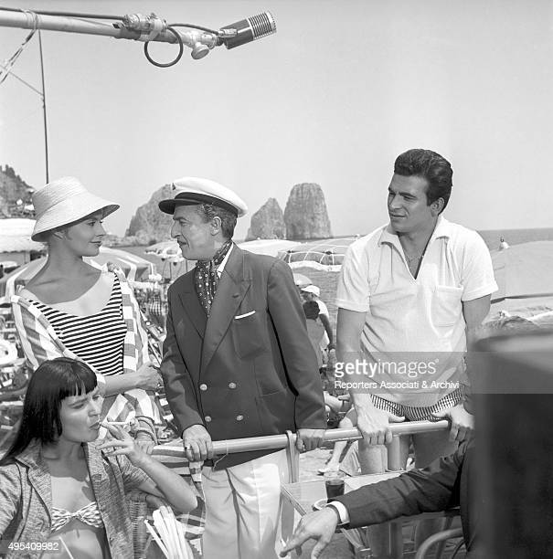 Italian actor and comedian Nino Taranto French actress Yvonne Monlaur and Italian actor Maurizio Arena gathered at the Piazzetta of Capri in a scene...