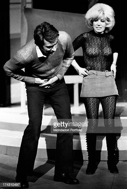Italian actor and comedian Walter Chiari joking with Italian actress Emy Eco during a break of Nude Look Brescia 1971