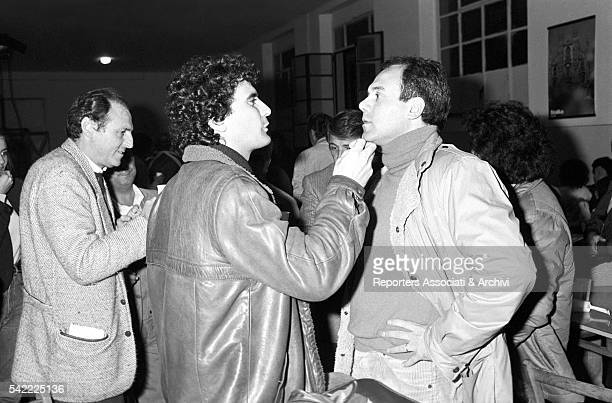Italian actor and director Carlo Verdon talking to Italian actor Massimo Troisi on the set of Morto Troisi viva Troisi Next to them is Italian...