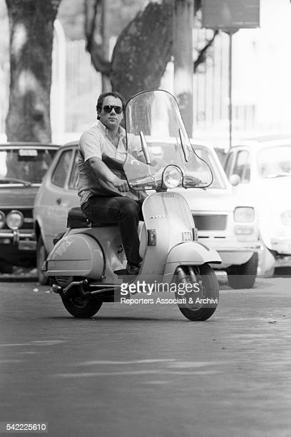 Italian actor and director Carlo Verdone riding a vespa in the streets of Rome Rome 1978