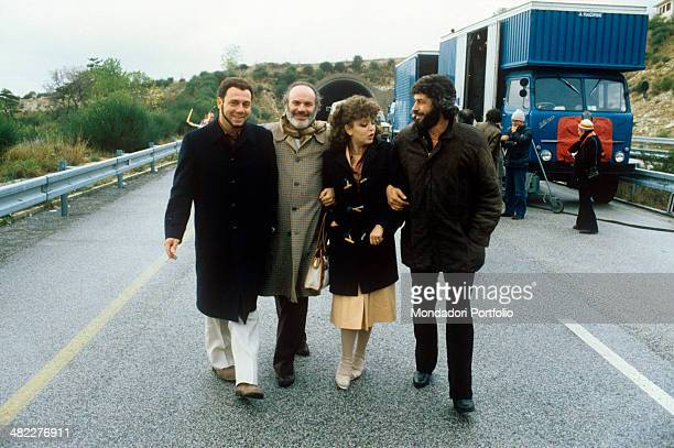 Italian actor and director Carlo Verdone walking with Italian actors Angelo Infanti and Mario Brega and Russian actress Irina Sanpiter in the film...