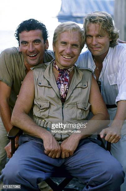 Italian actor and director Massimo Troisi American actor Robert Duvall and American actor John Savage smiling on the set of the film Hotel Colonial...