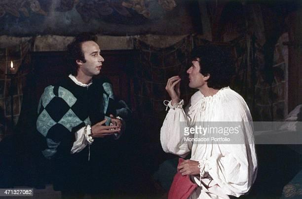 Italian actor and director Massimo Troisi gesticulating beside Italian actor and director Roberto Benigni in the film Non ci resta che piangere 1984