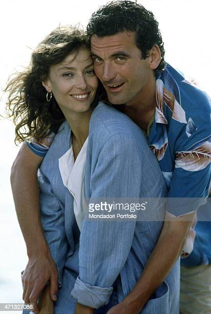 Italian actor and director Massimo Troisi hugging British actress Rachel Ward on the set of the film Hotel Colonial Mexico 1986