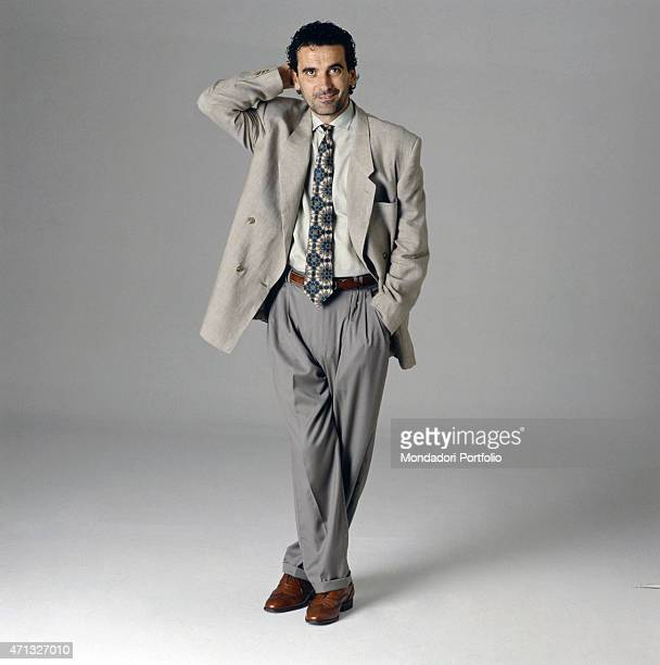 Italian actor and director Massimo Troisi posing for a photo shooting in suit 1989