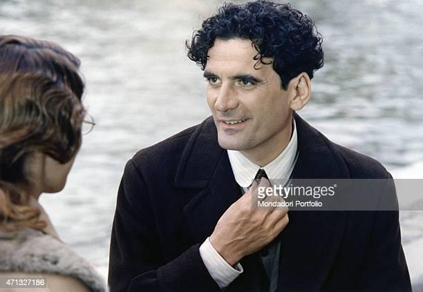 Italian actor and director Massimo Troisi tying his tie in the film Le vie del Signore sono finite 1987