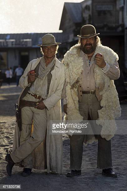 Italian actor and director Terence Hill and Italian actor Bud Spencer smiling with an apple in the hand in the film Troublemakers Santa Fe 1994