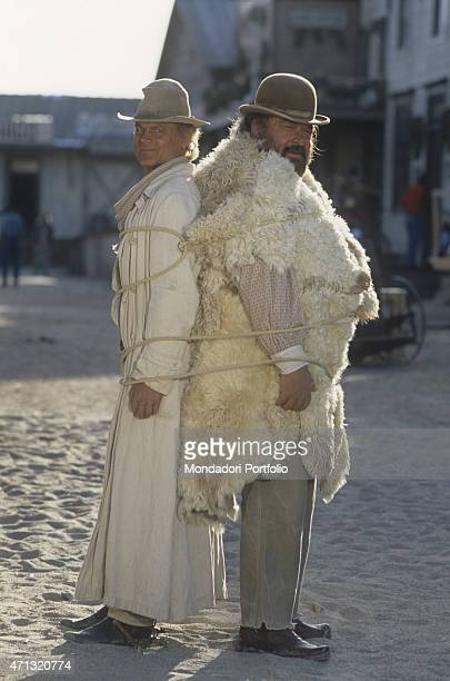 Italian actor and director Terence Hill and Italian actor Bud Spencer standing tied together by a rope on the set of the film Troublemakers Santa Fe...