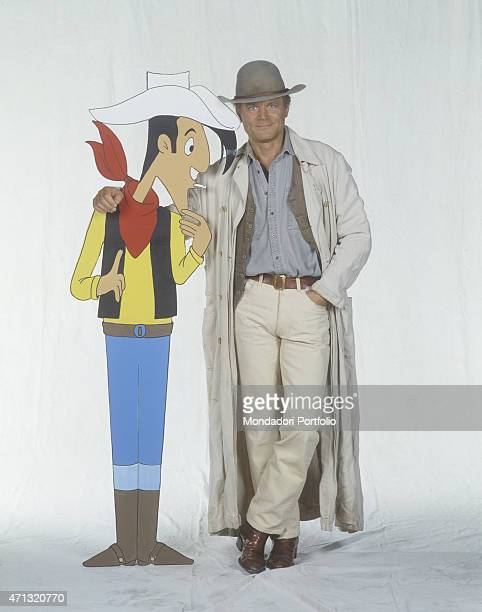Italian actor and director Terence Hill dressed as a cowboy posing beside the silhouette of the comic character created by Morris Lucky Luke 1992