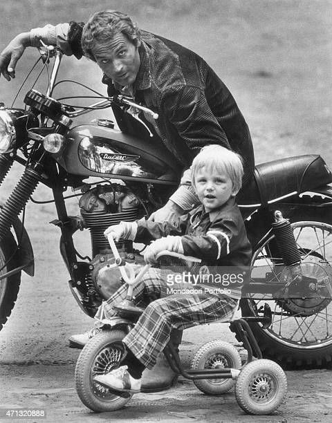 Italian actor and director Terence Hill sitting on a Ducati motorbike beside his American son Jess Hill on the set of the film Watch Out We're Mad...