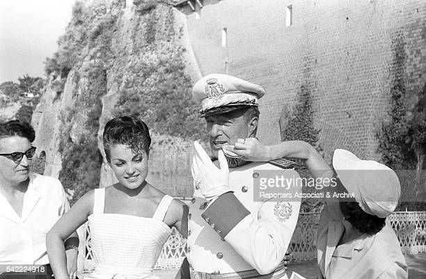 Italian actor and director Vittorio De Sica having his makeup done with Spanish actress Carmen Sevilla on the set of Bread Love and Andalucia...