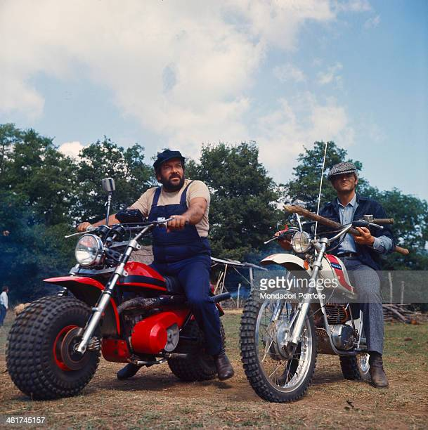 Italian actor and scenarist Bud Spencer and Italian actor director and scenarist Terence Hill riding two motocross in the film altrimenti ci...