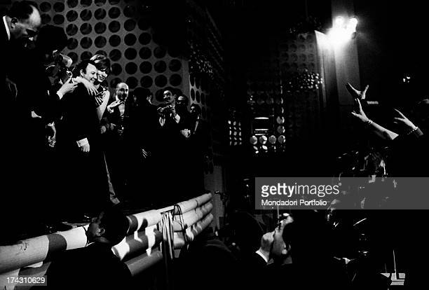 Italian actor and singer Claudio Villa greeted by the crowd after having won the 17st Sanremo Music Festival Sanremo January 1967
