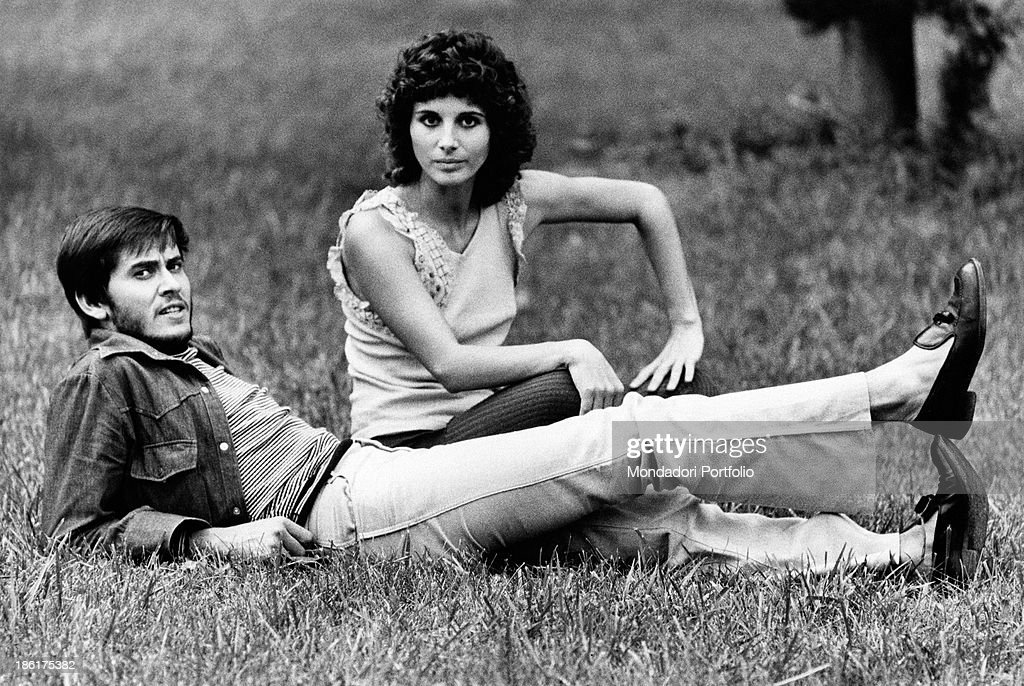 Italian actor and singer Gianni Morandi lying on the grass beside Italian actress Paola Pitagora They're in the Italian capital city because of the...