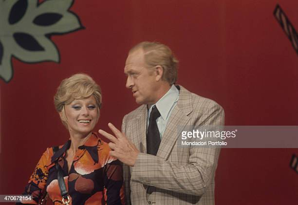 'Italian actor and TV host Raimondo Vianello gesticulating beside his wife and Italian actress Sandra Mondaini They present together the TV variety...