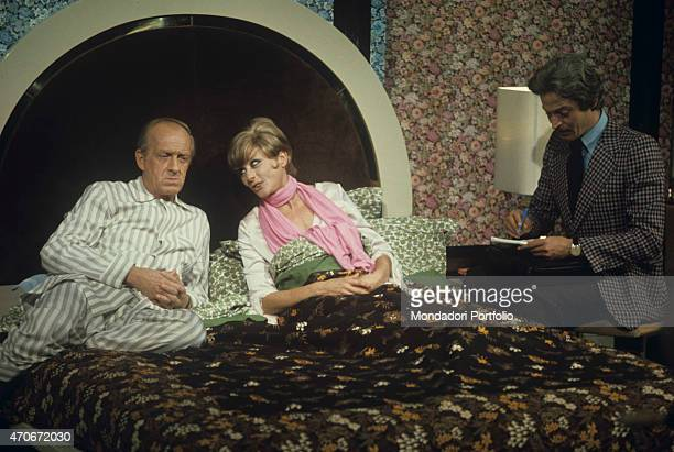 'Italian actor and TV host Raimondo Vianello in pyjamas sitting on a bed his wife and Italian actress Sandra Mondaini They present together the TV...