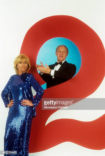 Italian actor and TV host Raimondo Vianello pointing at his wife and Italian actress and TV presenter Sandra Mondaini in the studio of the TV show...